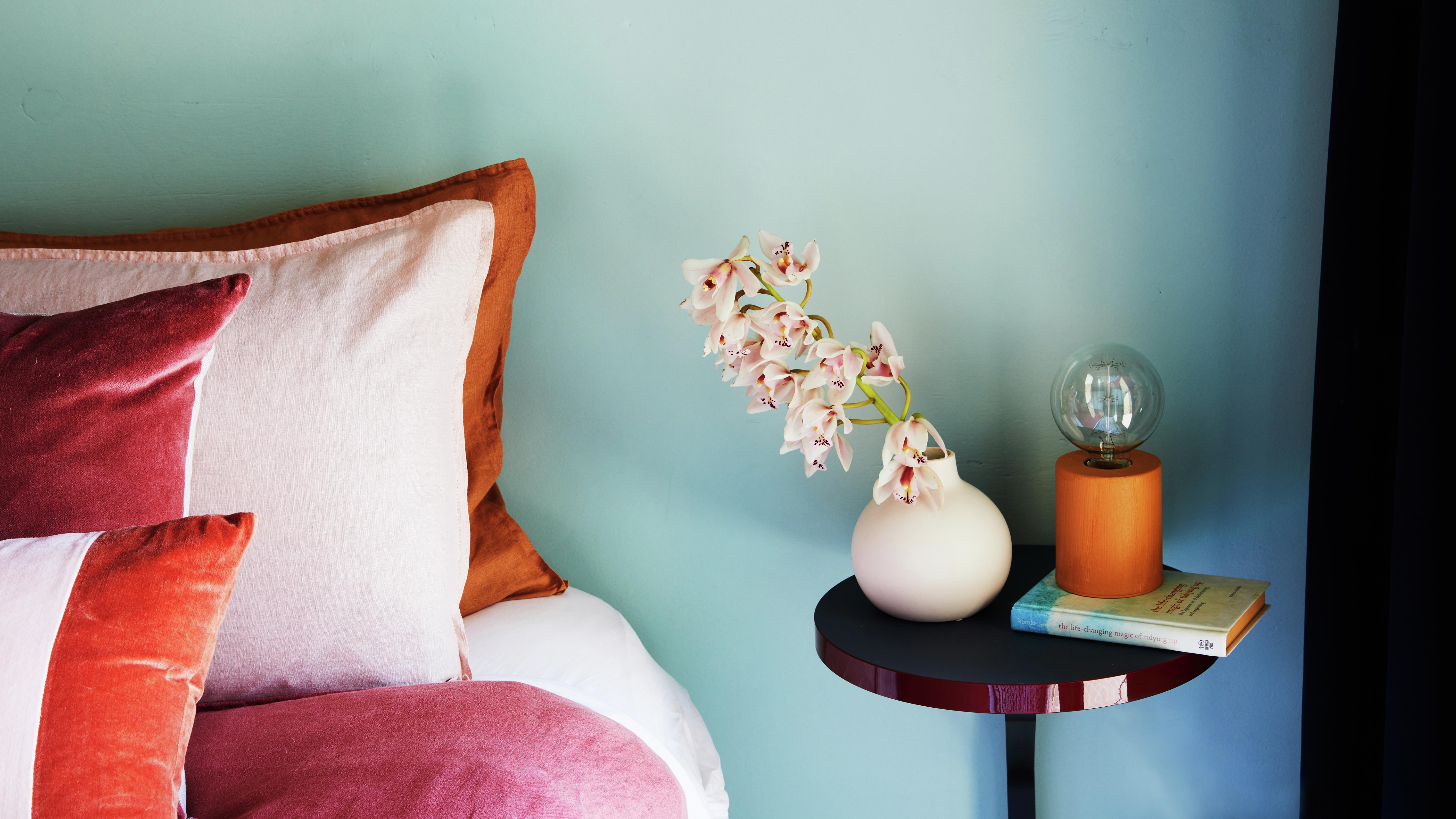 Cosy bedroom styled with a cool colour palette
