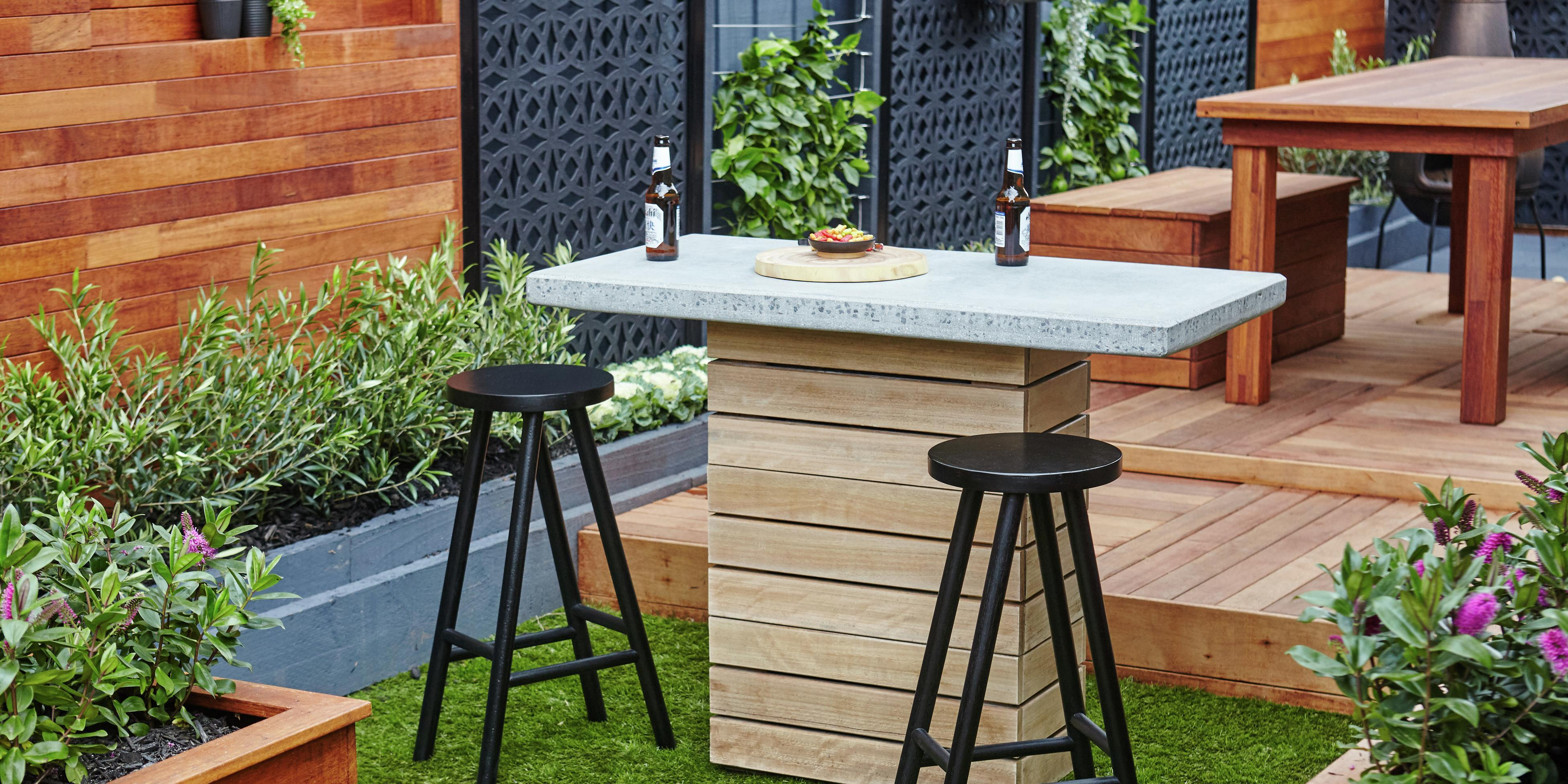 Backyard with timber decking and a small bar