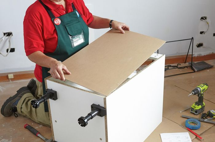 DIY Step Image - How to assemble a linen chute cupboard . Blob storage upload.