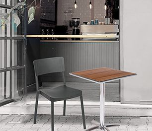 Chair and table in front of a small bar