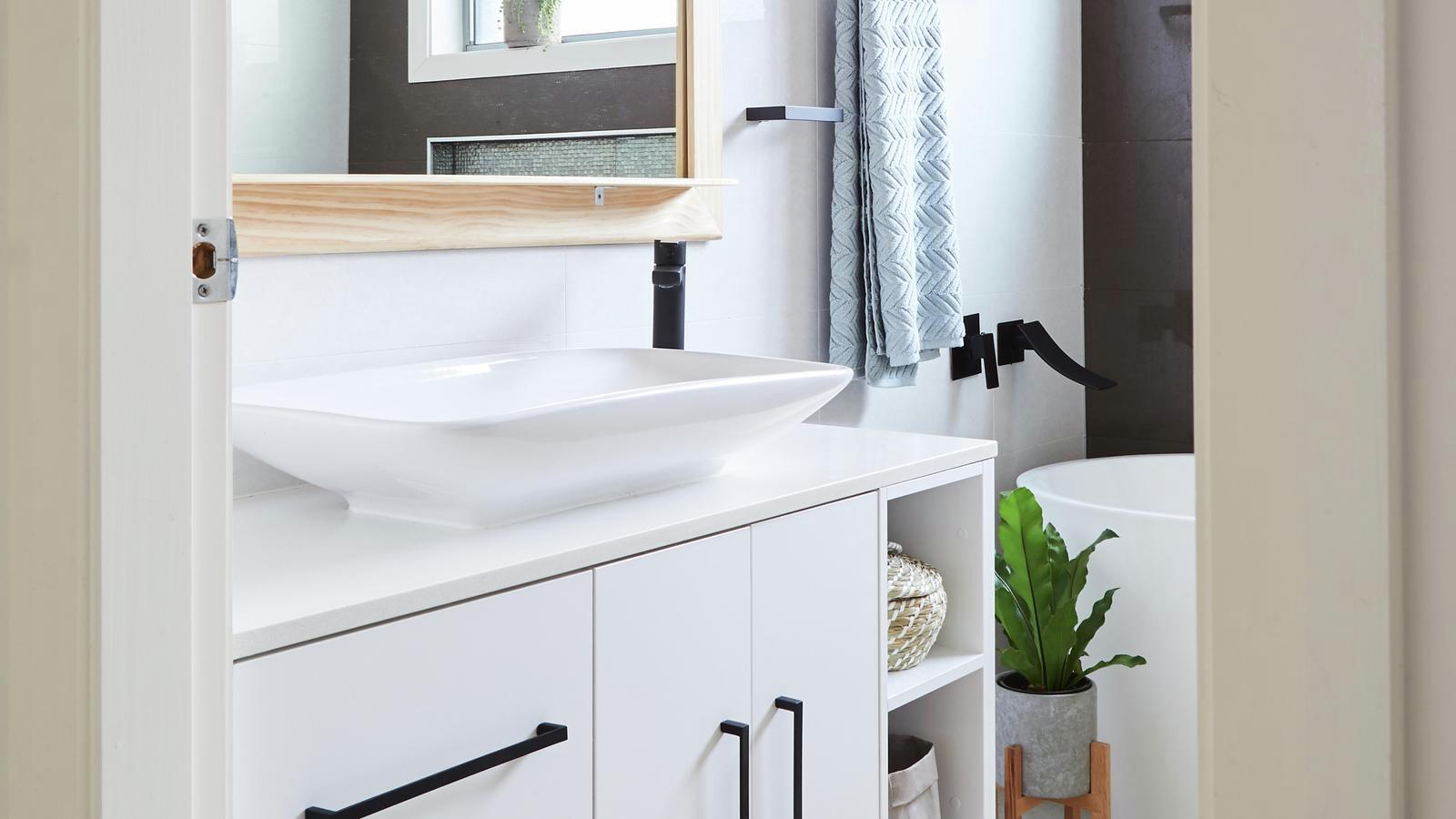 modern bathroom with basin and cabinets