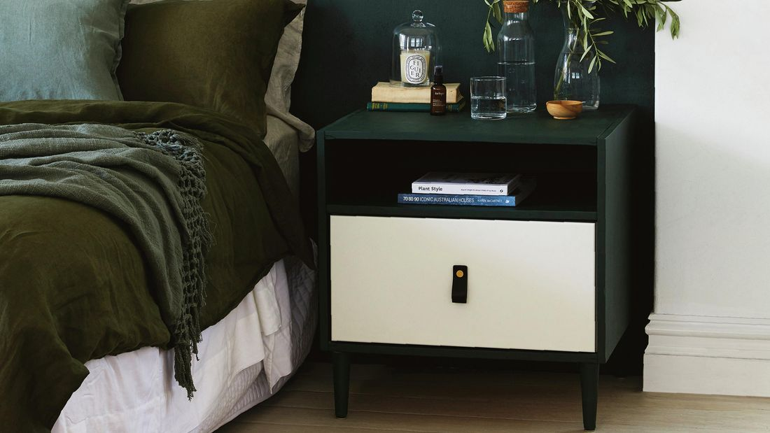 Black and white bedside table in bedroom.