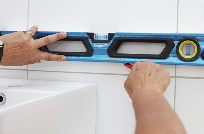 DIY Step Image - How to install a bathroom mirror . Blob storage upload.