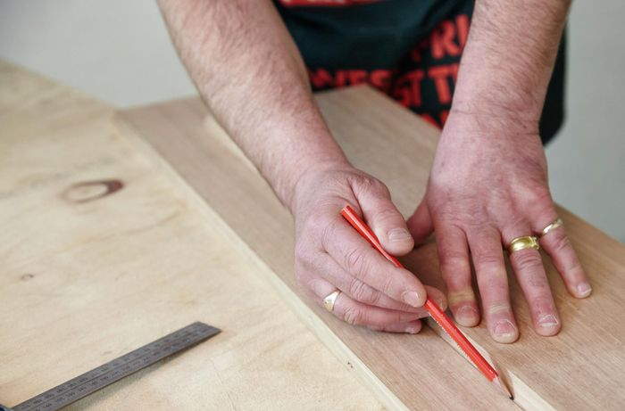 Marking a piece of timber for cutting