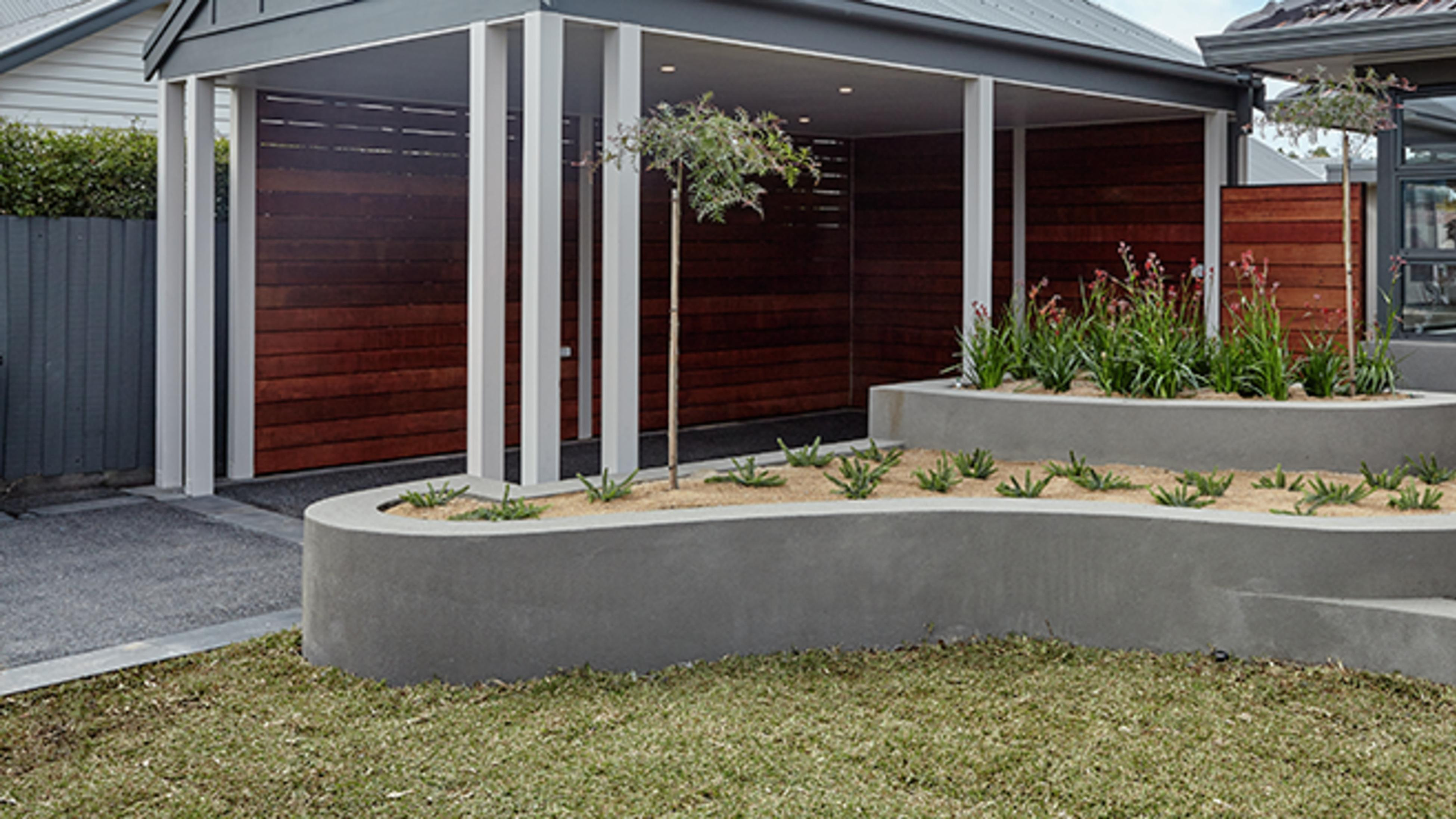 Front entry to house with raised garden beds and lawn