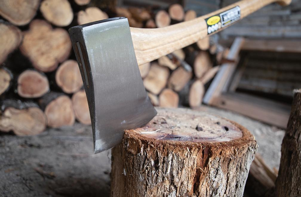 Close up of Axe chopping timber log