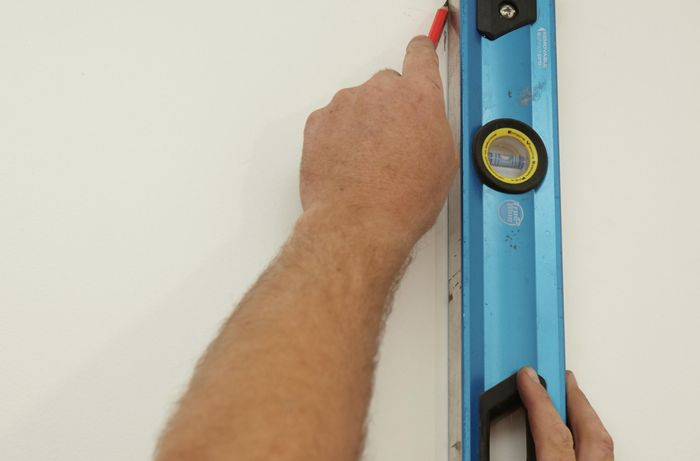Locating the stud in the wall with a stud finder
