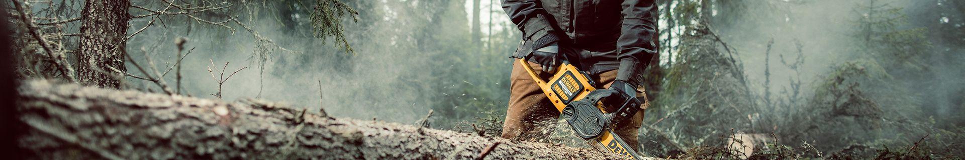 Chainsaw cutting through log
