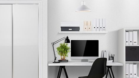 Study space with desk, floating shelving unit and cube storage unit