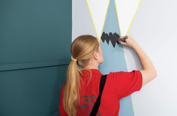 Person painting wall.