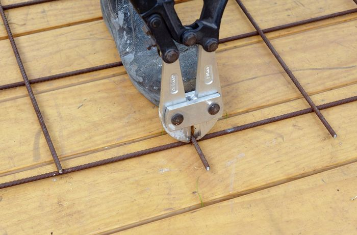 Heavy duty wire cutters used to trim excess wire from the ends of a frame