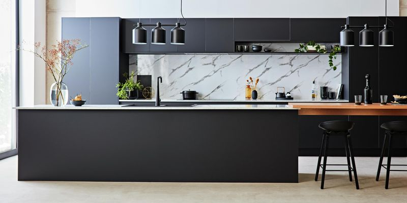 Modern Kitchen with matte finish cupboards, marble splashback and a floating dining bench area.
