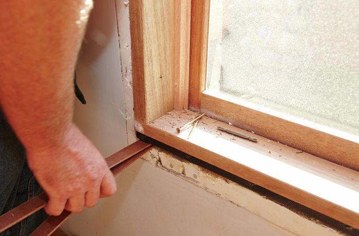 Using masonite packers to level the window