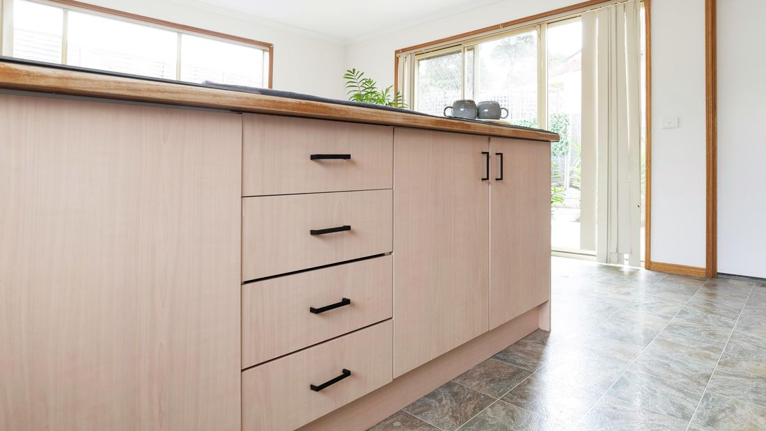 Kitchen drawers with new black handles.
