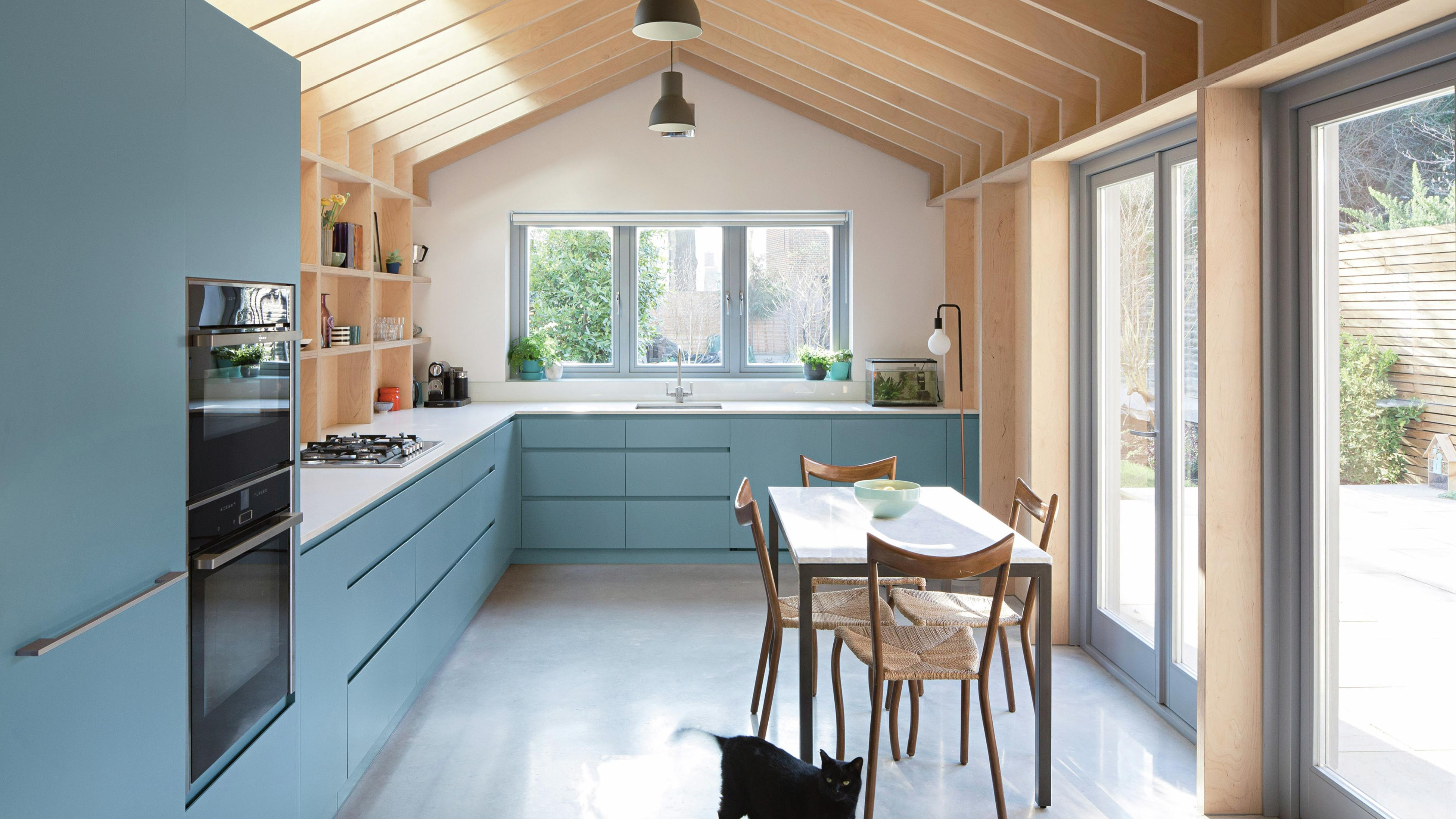 Blue cabinets - Dining table - Kitchen - Wide - PPG Paints