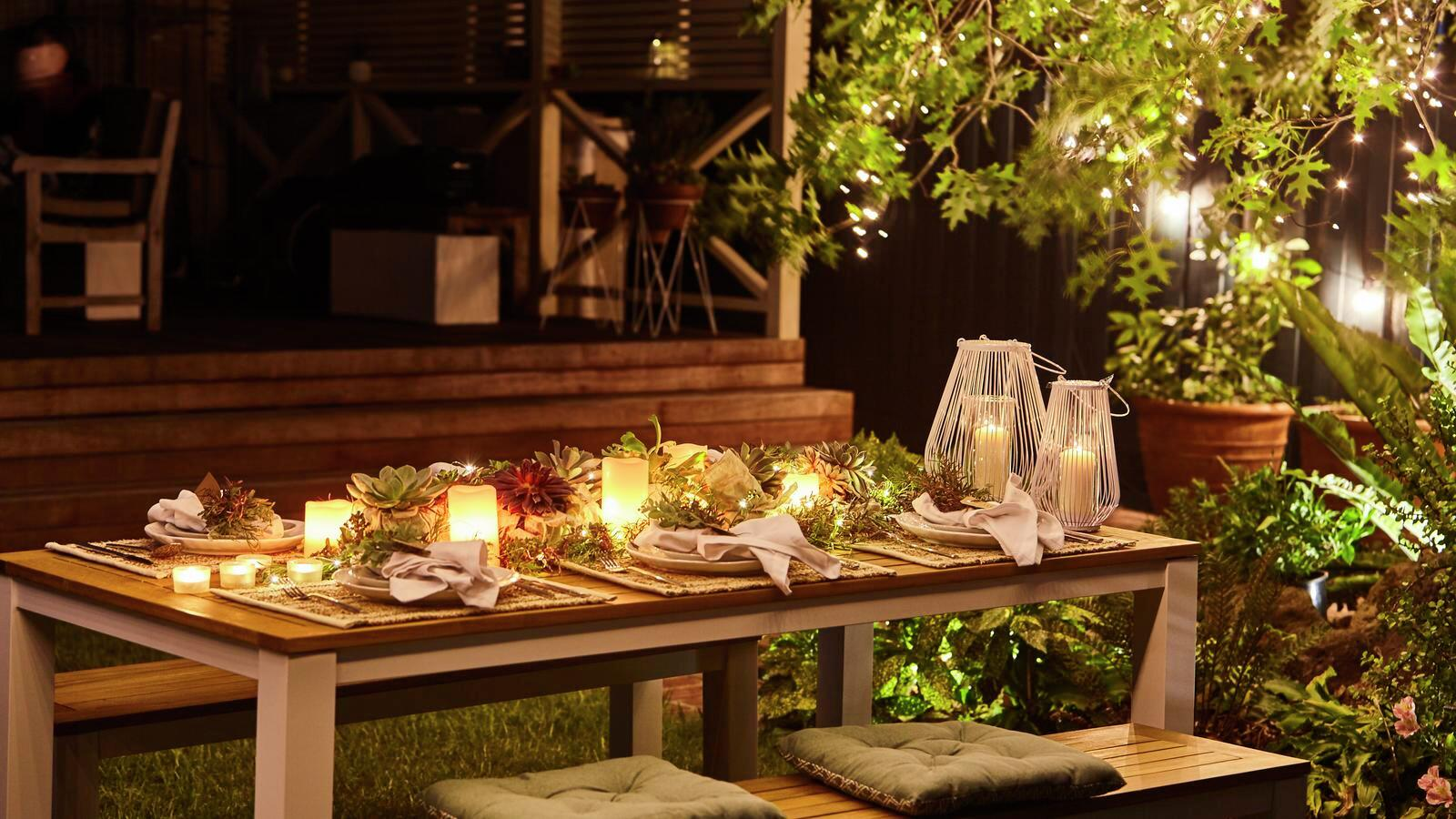Outdoor entertaining - Dining - Furniture - Lighting - Night time - String lights - Candles