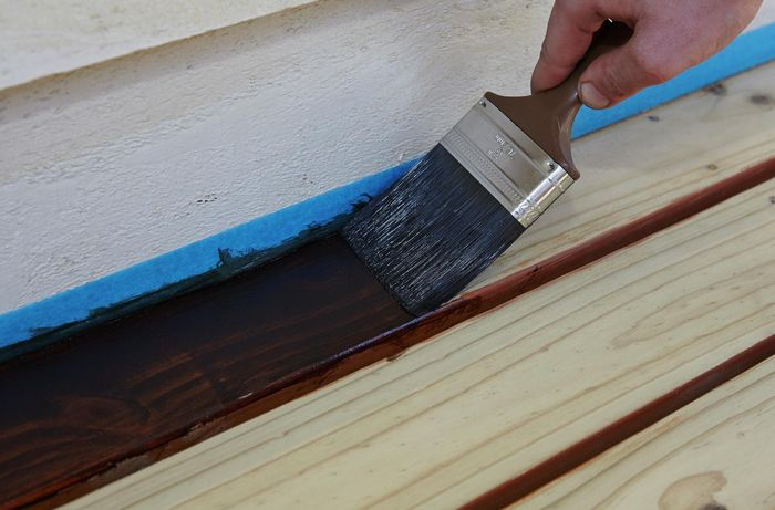 DIY - Step 2 - Stain edges and corners with paint brush - How to stain a deck