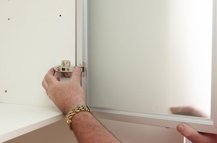 DIY Step Image - How to install frosted glass doors . Blob storage upload.