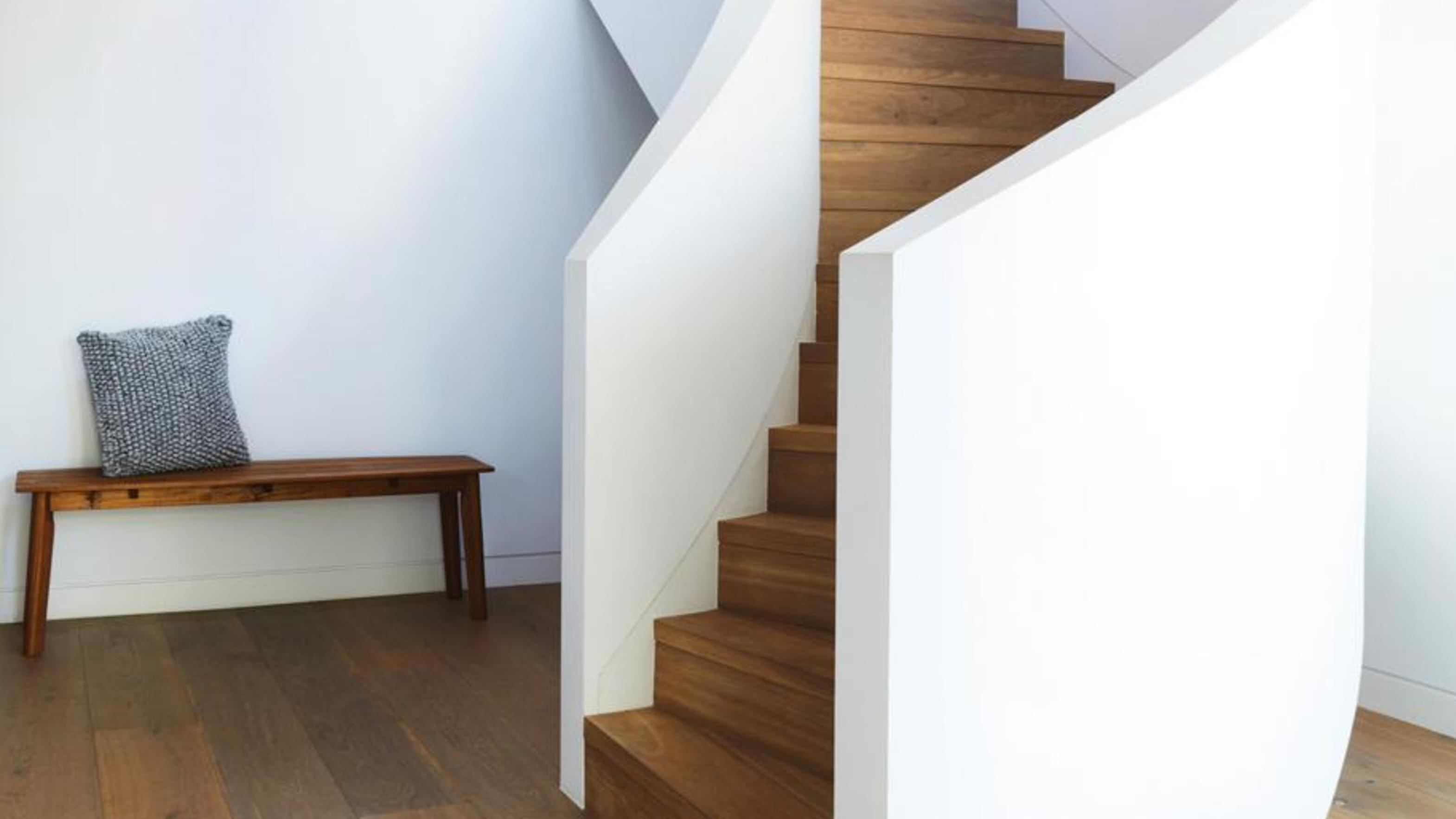 Wooden staircase and timber floorboards.