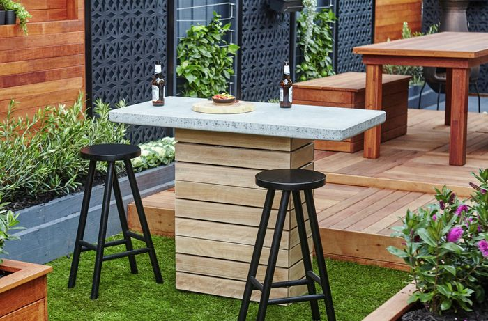 Completed bar stools in an outdoor area around a drinking island with two beers