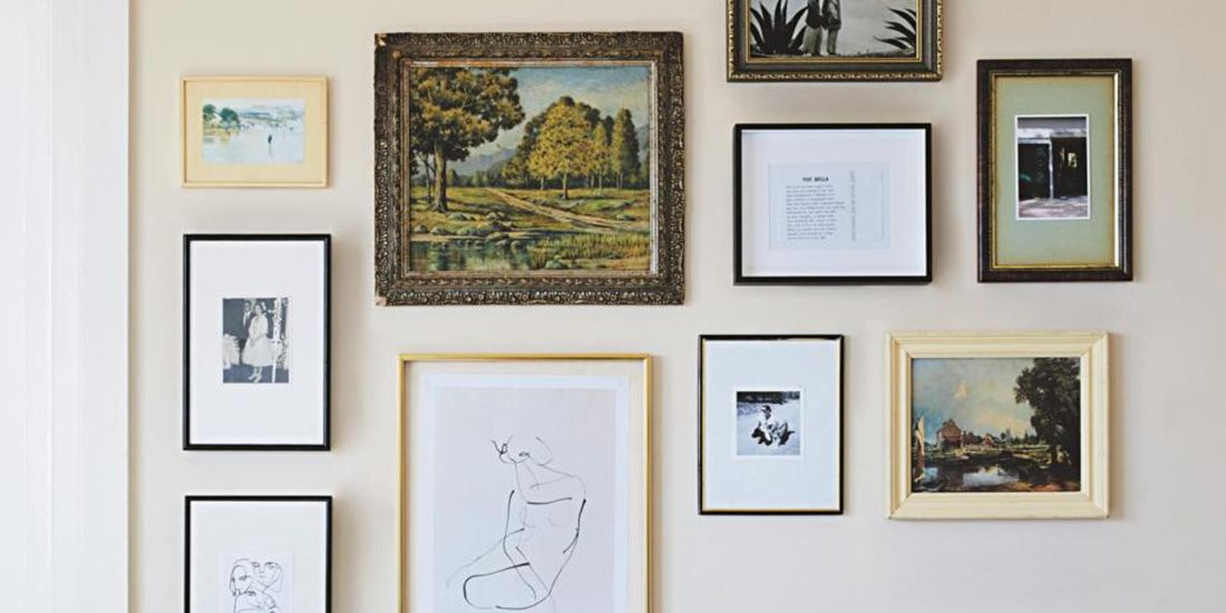 A collection of picture frames mounted on a wall