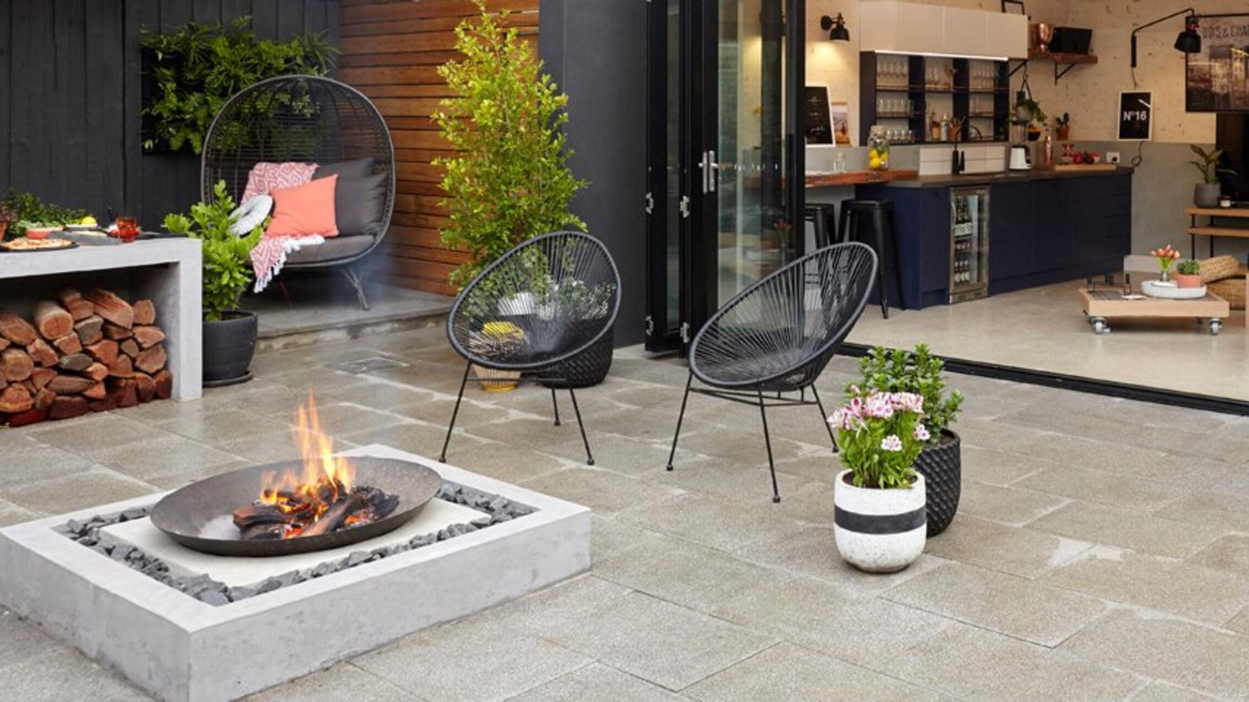 Outdoor area with lounge furniture and fire pit.