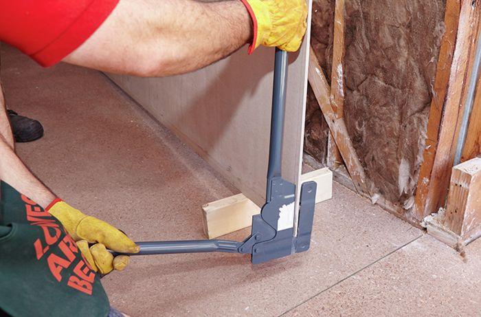 Short panels of villaboard being cut with a fibrocement cutter