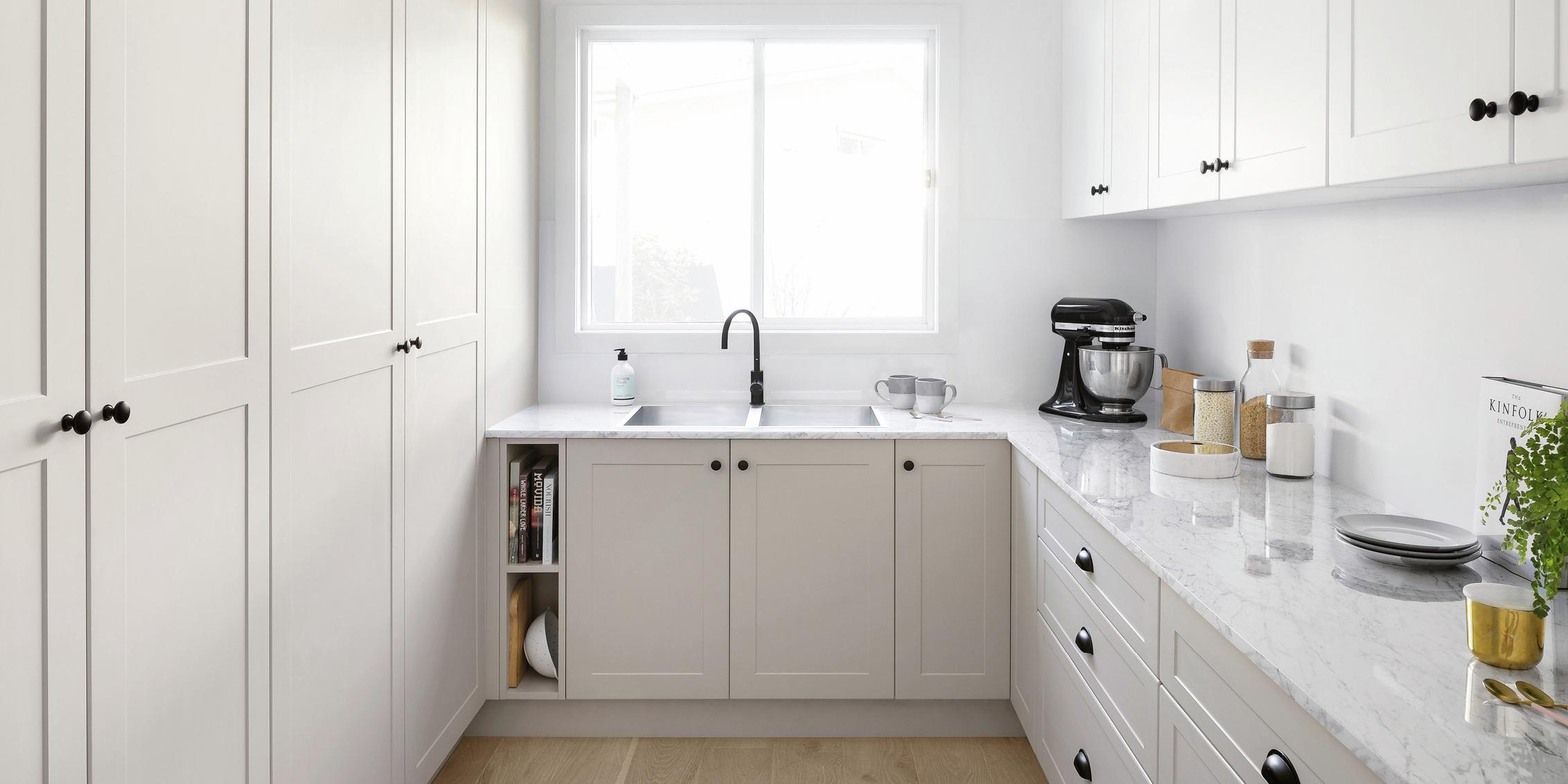 Kitchen with marble benchtop and cabinets and cupboards