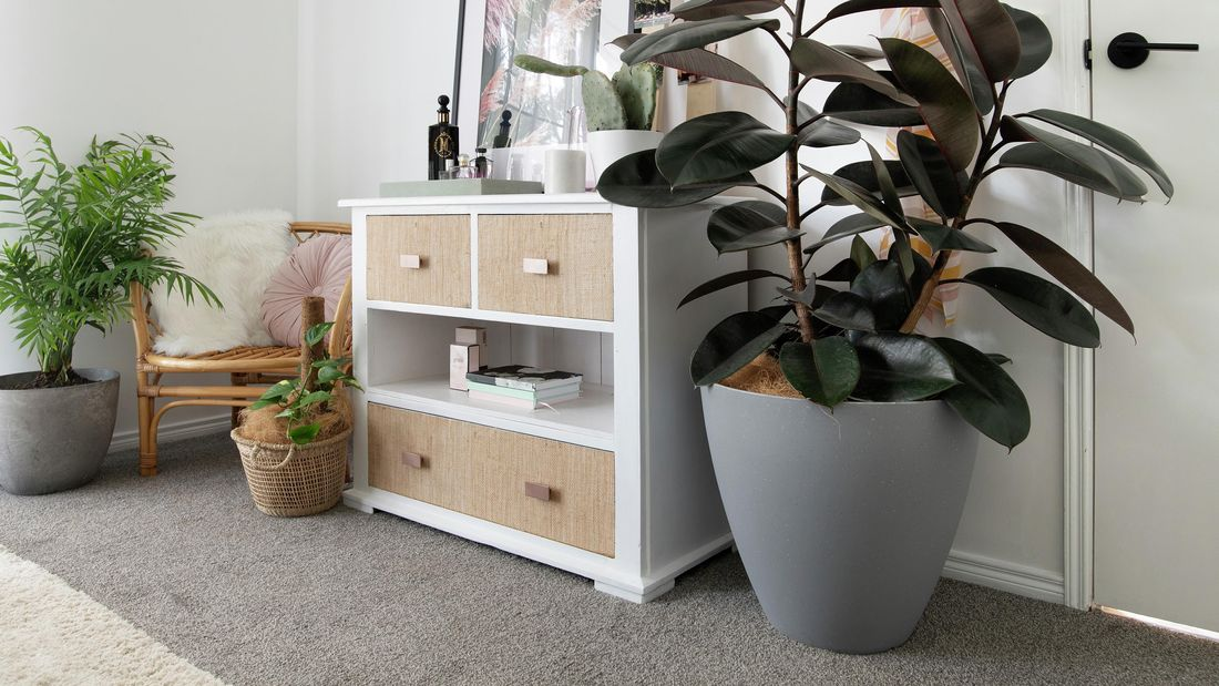 White chest of drawers with hessian covering on drawer fronts