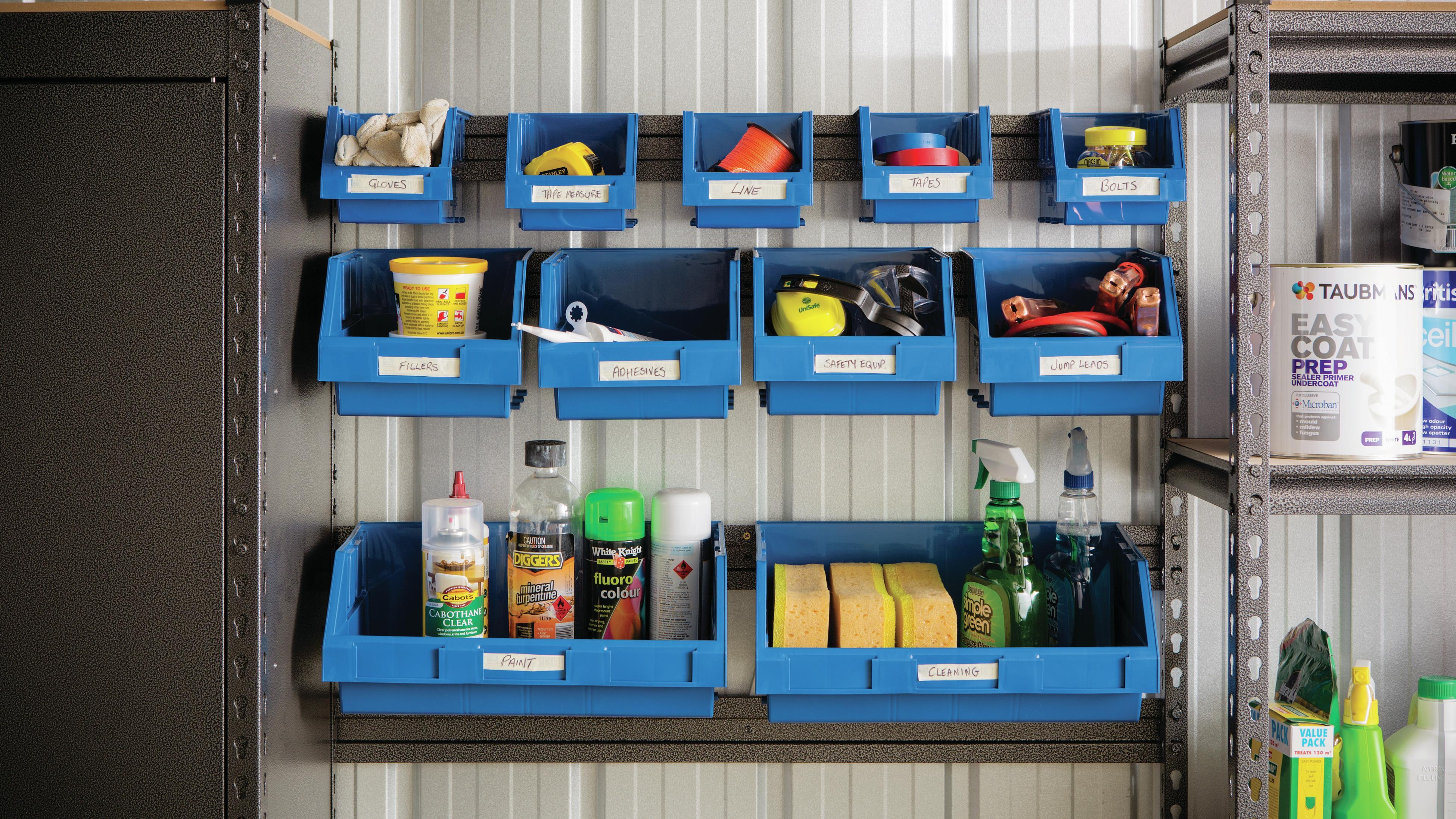 Garage shelving with assortment of things hung up.