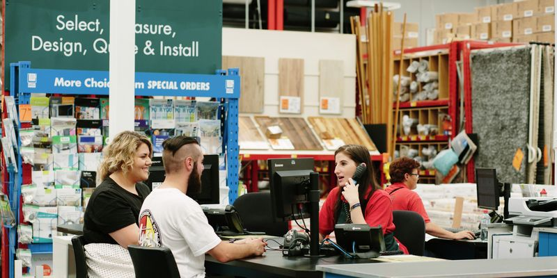 Customers being served at a Bunnings Special Orders desk.