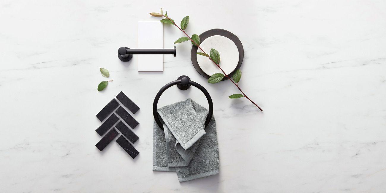 Black matte bathroom fittings on a marbletable