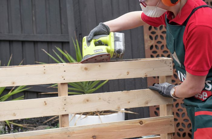 A pallet being sanded down