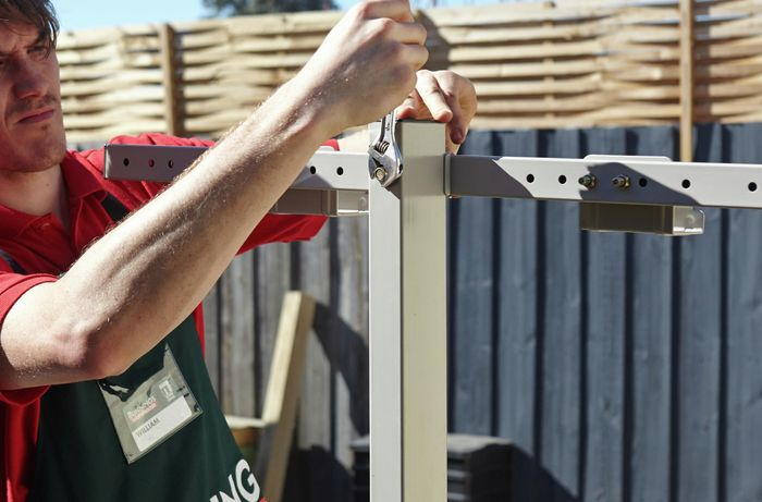 Attaching the universal bracket to the post of a retractable clothesline.
