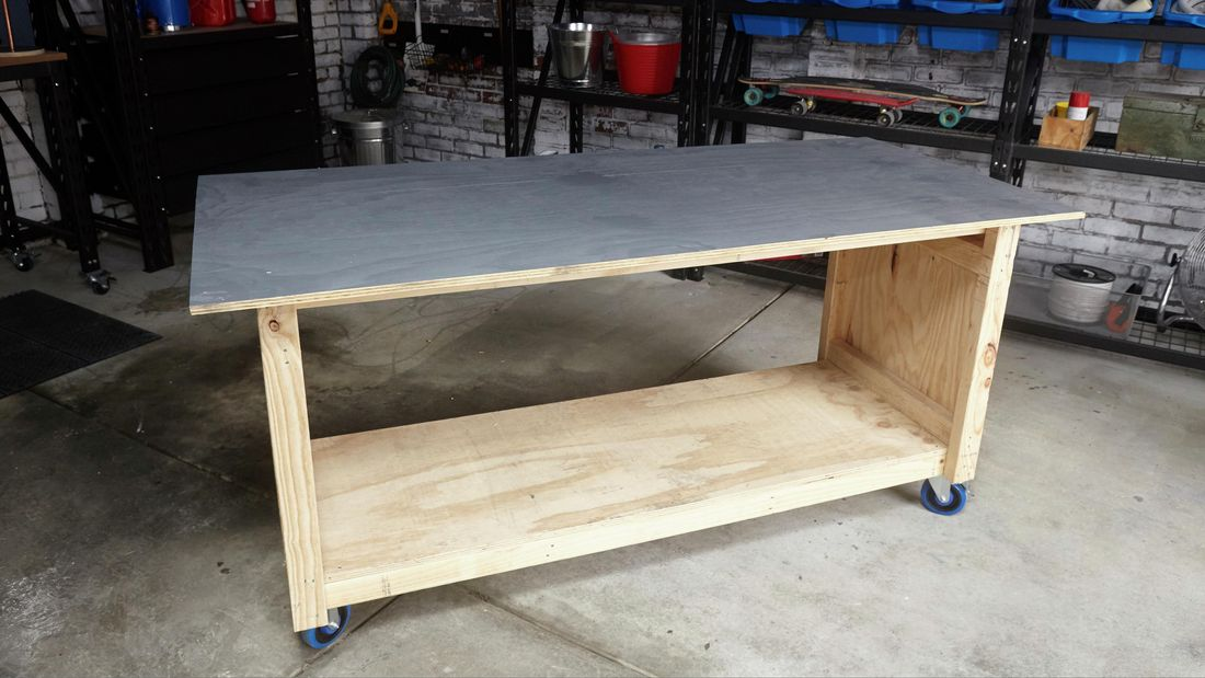 A mobile workshop bench made from pine and plywood with swivel castor wheels