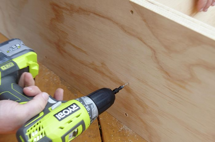 A hole being drilled for screws to secure a shelf