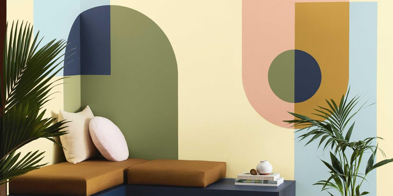 lounge with geometric feature wall, cushions and a rug