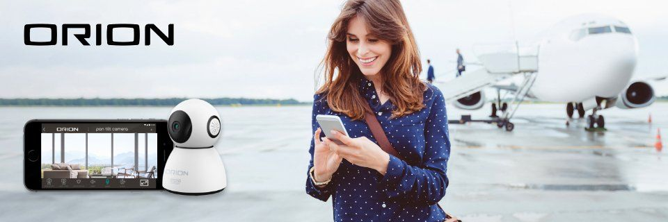 Woman checking phone as she comes off plane.