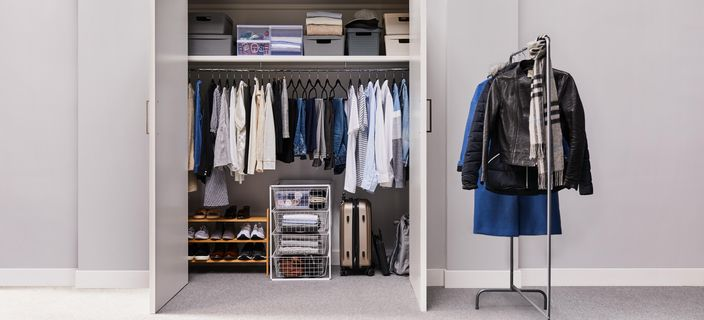 wardrobe with clothes and a portable wardrobe