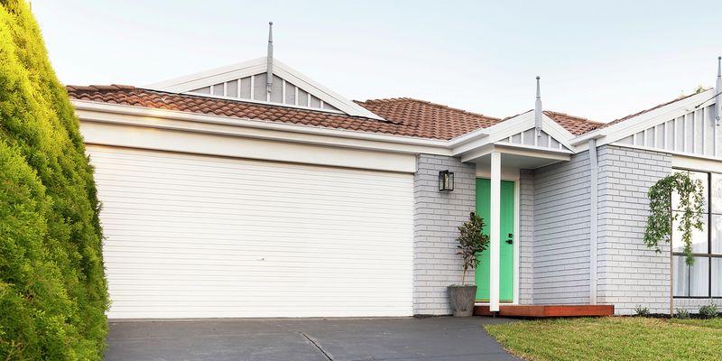 Front of a house, showing garage door.