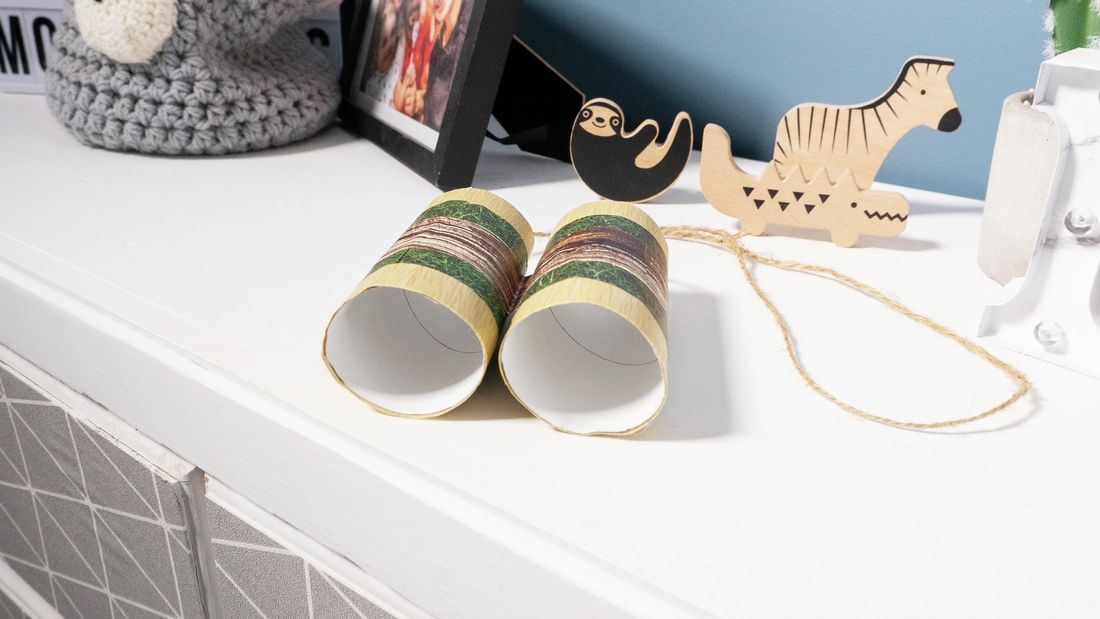 Binoculars crafted from two toilet rolls stuck together