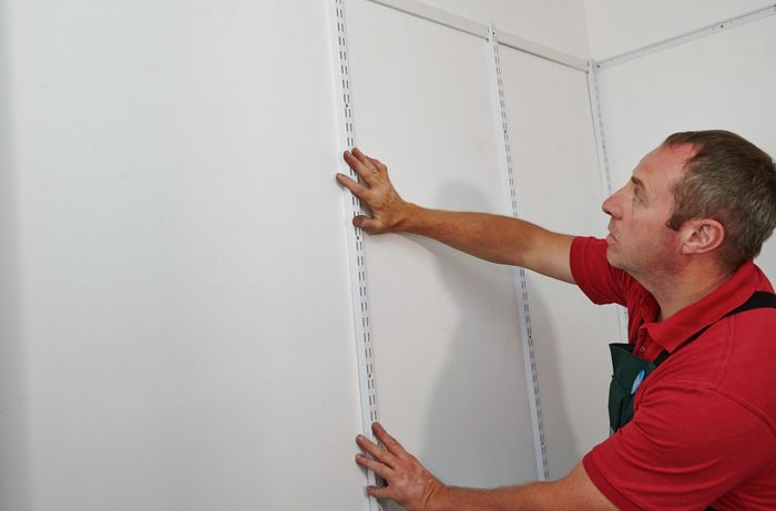 DIY Step Image - How to install a wire wardrobe system . Blob storage upload.