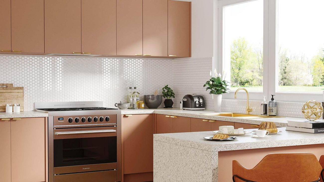 Pink kitchen with white honeycomb tiles and granite benchtop