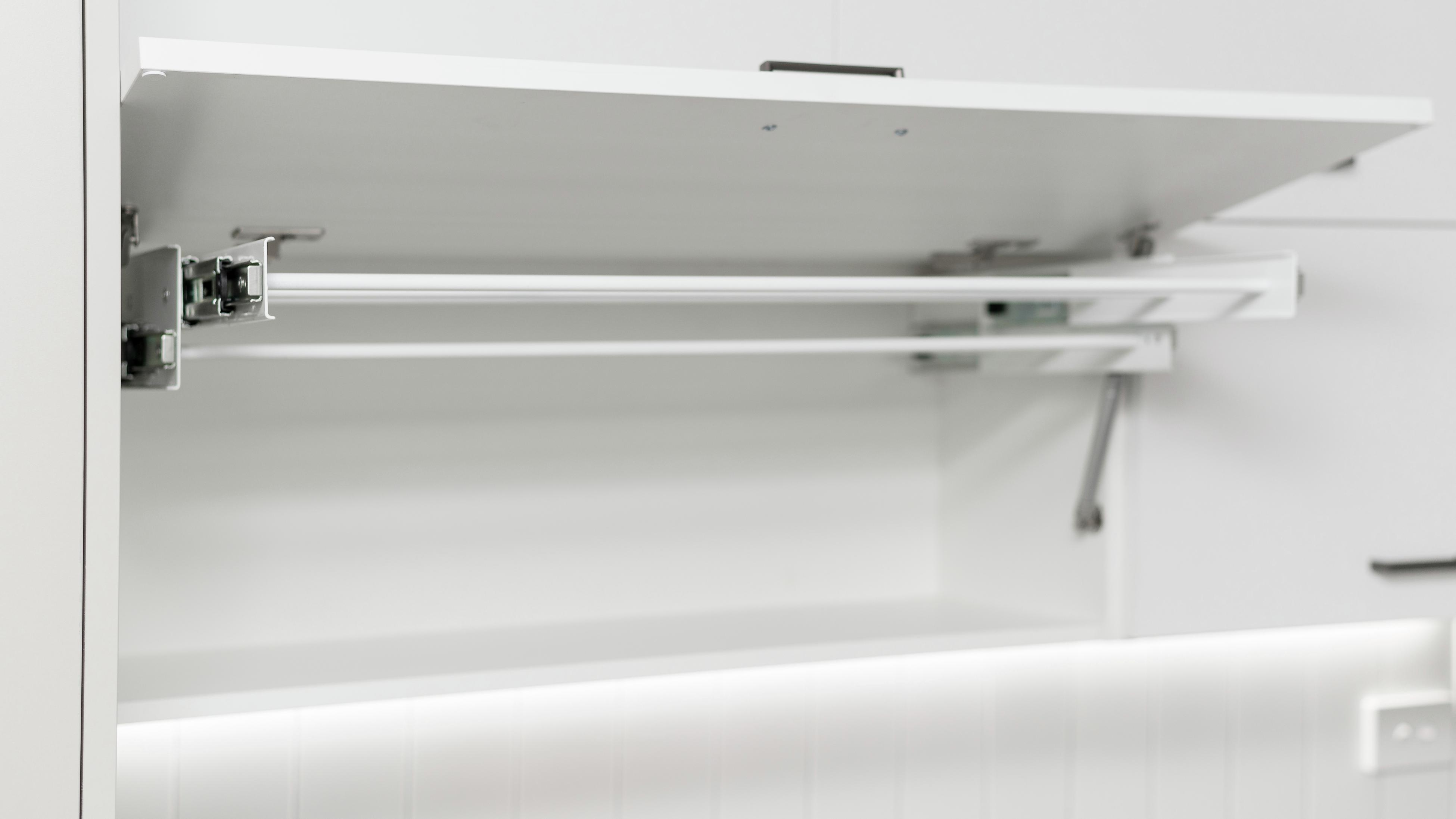 Hanging clothes rail.