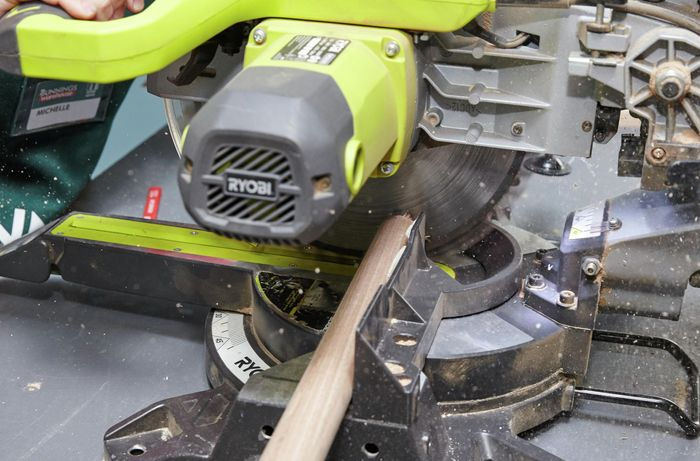 Person cutting timber for bedhead using circular saw