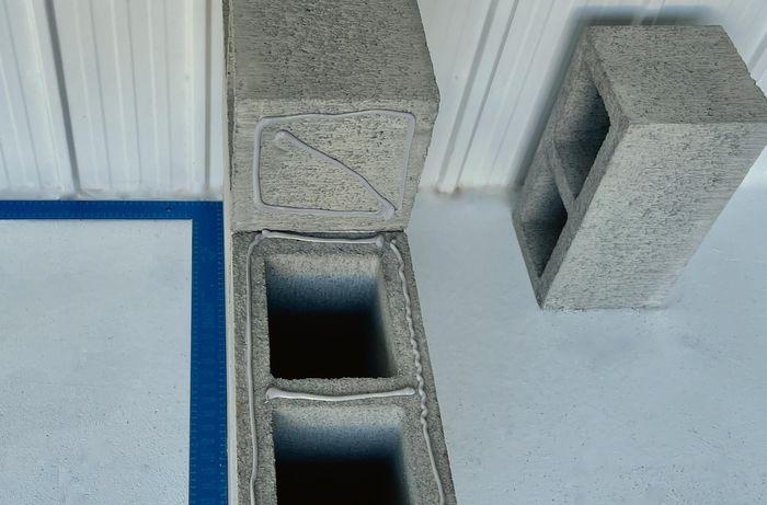 Landscape adhesive applied to besser blocks
