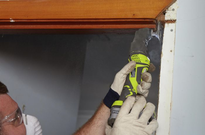 A notch being cut out of a wall to make room for a new door jamb