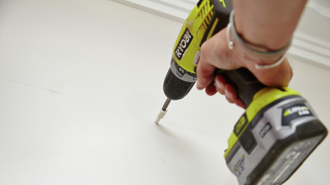 Wall plugs being drilled into a wall to cater for wall mounted brackets