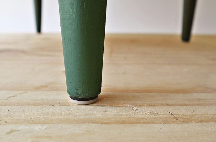 Glides added to the bottom of bedside table legs