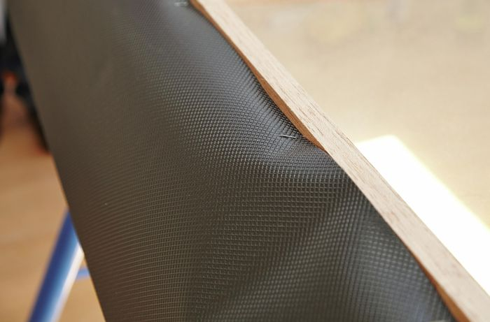 A strip of waterproof flashing stapled onto the rear of the window frame